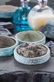 Ancient nature minerals, different types of clay used for skincare, spa treatments, face masks, gray, black, green and blue stock image