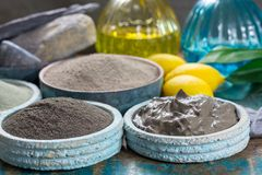 Ancient nature minerals, different types of clay used for skincare, spa treatments, face masks, gray, black, green and blue stock photography