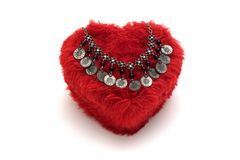 Ancient necklace. On a heart shaped box Royalty Free Stock Photo