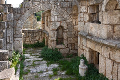 Ancient Necropolis, Tyre, Lebanon. The old byzantine road at the Tyre archeological site is lined with hundreds of sarcophagii and tombs making up a huge Royalty Free Stock Photo