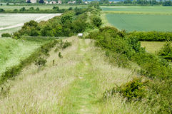 Ancient neolithic ditch and bank Stock Photo