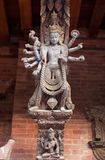 Ancient Nepalese wooden carving with hindu gods in Patan, Nepal. Ancient Nepalese wooden carving with hindu gods at the columns in palace on Durbar square in stock photography