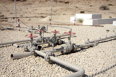 Ancient network of oil piplines of I gulf oil well Stock Photography