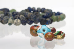 Ancient and new glass beads. On white background Stock Photos