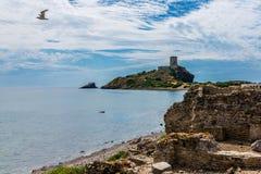 Ancient Nora Tower in Sardegna. Ancient Sardinian ruins of Nora, Sardinia, ancient spanish tower of Coltellazzo, Pula, Sardegna, Italy royalty free stock photography