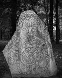 Ancient Nordic Runestone in Dark Forest. Ancient Nordic Runestone In Stockholm Sweden Close to Karlberg Castle Royalty Free Stock Image