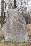 Ancient Nordic Runestone. Standing in the Forest Close to Karlberg Castle, Sweden Stock Photo