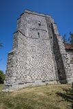 Flint stone tower of ancient St Mary`s Church Pevensey royalty free stock photography