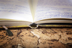 Ancient notebook with records on an old  background. Stock Images