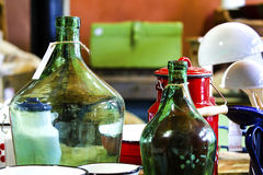 Ancient object of bottles and Vitreous enamel cass. Eroles form Romania in antique store Stock Photos