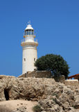 The ancient Odeon Amphitheatre with the lighthouse on the background. Paphos, Cyprus. Stock Image