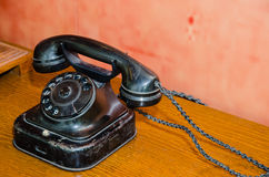 An ancient old black telephone Stock Image