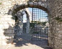 Ancient old castle stone doorway with iron gate stock photos