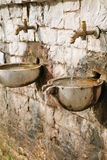 Ancient old exterior water tap with drinking water in Olympia. Stock Images