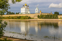 Ancient old fortress on the river bank bright clouds sky July 30rd 2016, Russia - Pskov Kremlin wall, Trinity Cathedral, Bell Towe Royalty Free Stock Photos