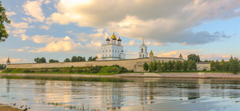 Ancient old fortress on the river bank bright clouds sky July 30rd 2016, Russia - Pskov Kremlin wall, Trinity Cathedral, Bell Towe Royalty Free Stock Photo