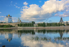 Ancient old fortress on the river bank bright clouds sky July 30rd 2016, Russia - Pskov Kremlin wall, Trinity Cathedral, Bell Towe Stock Images