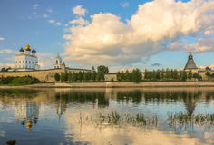Ancient old fortress on the river bank bright clouds sky July 30rd 2016, Russia - Pskov Kremlin wall, Trinity Cathedral, Bell Towe Stock Image