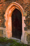 Ancient Old Gothic Door at sunset Stock Photography
