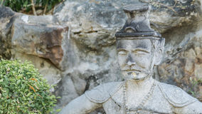 Ancient old man's face statue in asian style, Bangkok Thailand Royalty Free Stock Photos