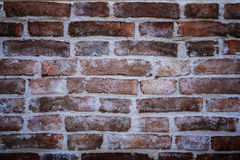 Ancient old red brick wall fragment with vignetted corners backg Royalty Free Stock Image