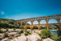 Ancient old Roman aqueduct of Pont du Gard, Nimes, France Royalty Free Stock Images