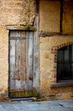 Ancient old textured building. Fine texture of grunge aged building, home related Stock Image