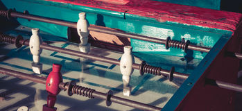 Ancient old wood classic aged Foosball table or table soccer with vintage effect photo style. Mini football concept Royalty Free Stock Photo