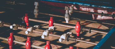 Ancient old wood classic aged Foosball table or table soccer with vintage effect photo style. Royalty Free Stock Photography