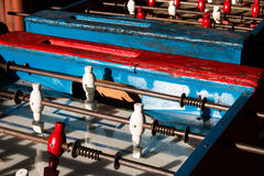 Ancient old wood classic aged Foosball table or table soccer with vintage effect photo style. Stock Photos