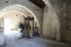 Ancient olive oil production machinery, stone mill and mechanical press royalty free stock photography