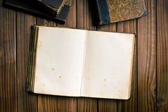 Ancient open book Stock Photos
