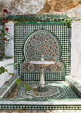 Ancient oriental fountain in Morocco. Stock Photos