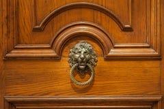 Ancient original bronze door handle with sculpter decor Royalty Free Stock Images