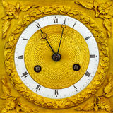 Ancient ornamental golden clock face Stock Photos