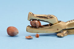 Ancient ornate bronze nuts cracker with hazelnuts Royalty Free Stock Photography