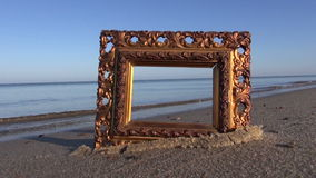 Ancient ornate picture frame on sea resort beach stock video footage