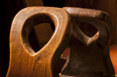 Ancient ornated wooden chair handles Stock Photography