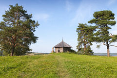 Ancient Orthodox chapel and stone cross on Savkina gorka Royalty Free Stock Photo