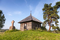 Ancient Orthodox chapel and stone cross on Savkina gorka Stock Images