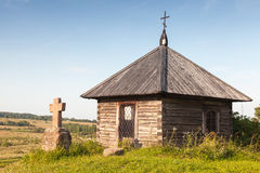 Ancient Orthodox chapel and a stone cross on Savkina gorka Royalty Free Stock Image