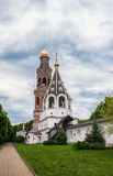 Ancient Orthodox Church with Golden domes and white stone bell tower in the monastery of the Ryazan region. Royalty Free Stock Photo