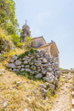 Ancient Orthodox church made of stone in the Byzantine style in Kotor Adriatic, Montenegro Stock Images