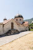 Ancient Orthodox church made of stone in the Byzantine style in Kotor Adriatic, Montenegro Royalty Free Stock Images