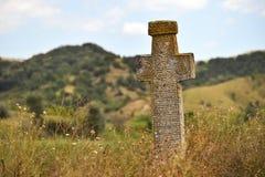 Ancient orthodox stone cross. Ancient stone orthodox cross deserted on a plain Stock Photo