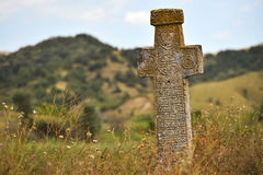Ancient orthodox stone cross. Ancient stone orthodox cross deserted on a plain Royalty Free Stock Image