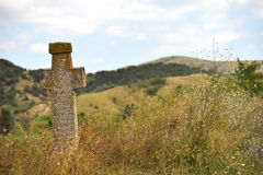 Ancient orthodox stone cross. Ancient stone orthodox cross deserted on a plain Royalty Free Stock Photography