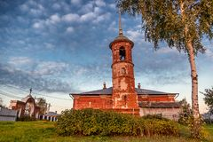Ancient Orthodox temple of red brick at sunset, traditional arch Royalty Free Stock Images