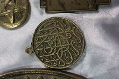Ancient gold color metal coin. Ancient Ottoman metal coin in view Stock Images