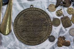 Ancient gold color metal coin. Ancient Ottoman metal coin in view Stock Photography